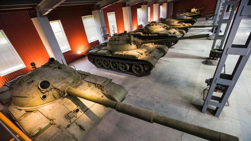 In this photo taken on Friday, May  29, 2015, a line-up of Soviet-era tanks is displayed at a museum of the UralVagonZavod plant in the Ural's city of Nizhniy Tagil, Russia. The giant UralVagonZavod is one of the biggest industrial plants in the world, has been the main manufacturer of tanks for the Soviet and then Russian military since World War II. (AP Photo/Alexander Zemlianichenko)