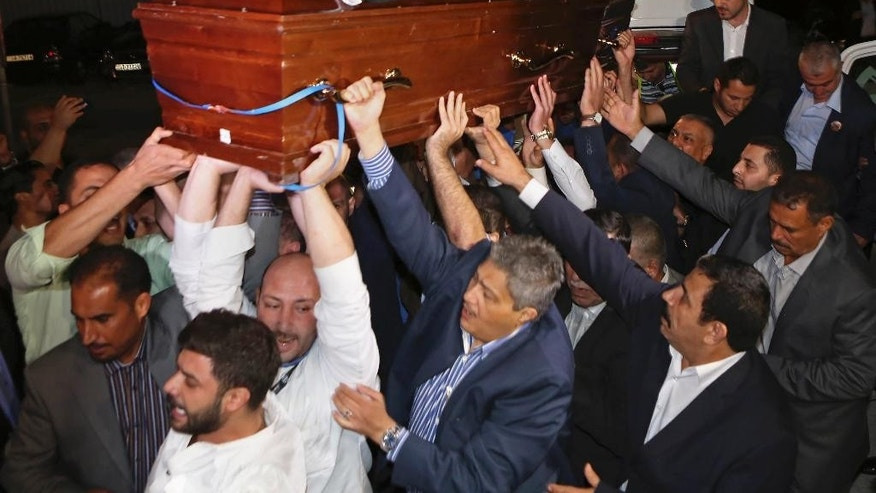 Relatives and supporters of Tariq Aziz, the only Christian in Saddam Hussein's inner circle, carry his  body outside the Arab Medical Center, in Amman, Jordan, early  Saturday, June 13, 2015. Aziz died June 5 at age 79. He had been in prison in Iraq since the U.S.-led invasion of Iraq in 2003 and suffered a series of strokes. He faced execution for his role in a government that killed hundreds of thousands of Iraqis. Jordan's government agreed to a request by Aziz's family to bury him in Jordan. (AP Photo/Khaled  Al Odat)