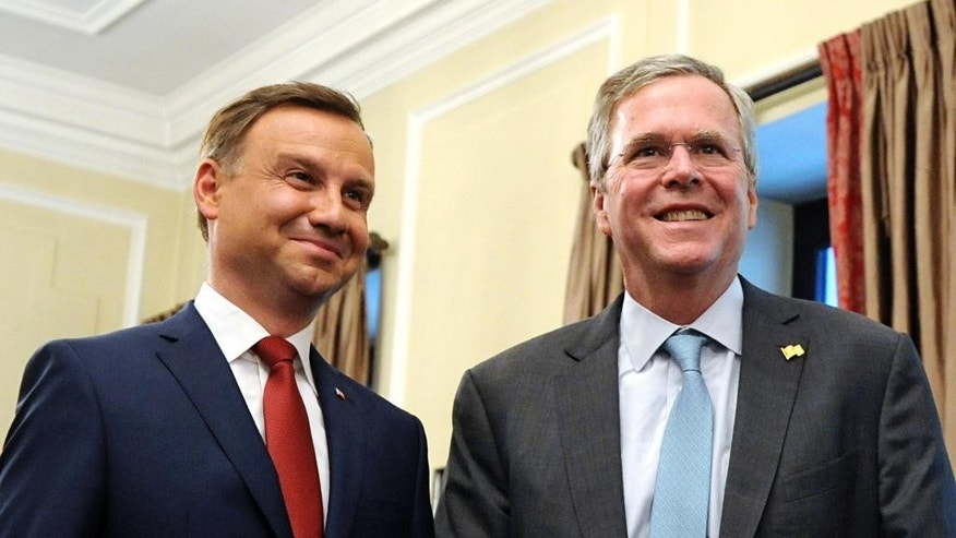 In this June 11, 2015, photo, former Florida Gov. Jeb Bush, right, meets Polish President-elect Andrzej Duda in Warsaw, Poland, Thursday, June 11, 2015. Bush strolled the halls of the Polish parliament. He praised Germany's economic boom since the fall of the Berlin Wall. And he visited Estonia, a once-bleak Soviet state that now has a growing, free-market economy. If he was trying to stoke memories of his father and his legacy as president, Bush appears to have largely succeeded.  (AP Photo/Alik Keplicz)