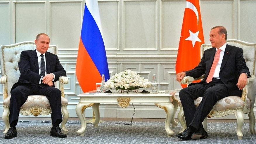 Russian President Vladimir Putin, left, and Turkish President Recep Tayyip Erdogan meet in Baku, Azerbaijan, Saturday, June 13, 2015.  Russian President Vladimir Putin attended the opening ceremony of the the 2015 European Games in Baku on Friday.  (Alexei Druzhinin/RIA-Novosti, Kremlin Pool Photo via AP)