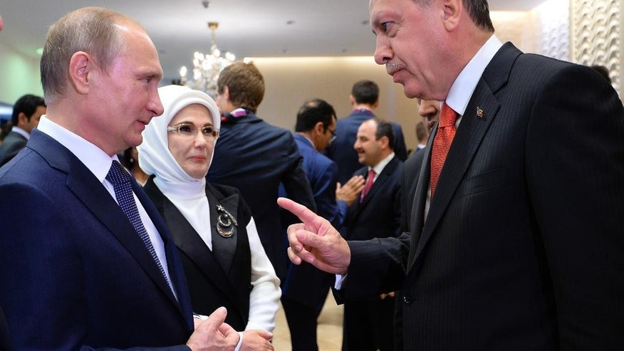 Russian President Vladimir Putin, left, listens to Turkish President Recep Tayyip Erdogan as they meet each other during the opening ceremony of the 2015 European Games in Baku, Azerbaijan, Friday, June 12, 2015. (RIA-Novosti, Kremlin Pool Photo via AP)