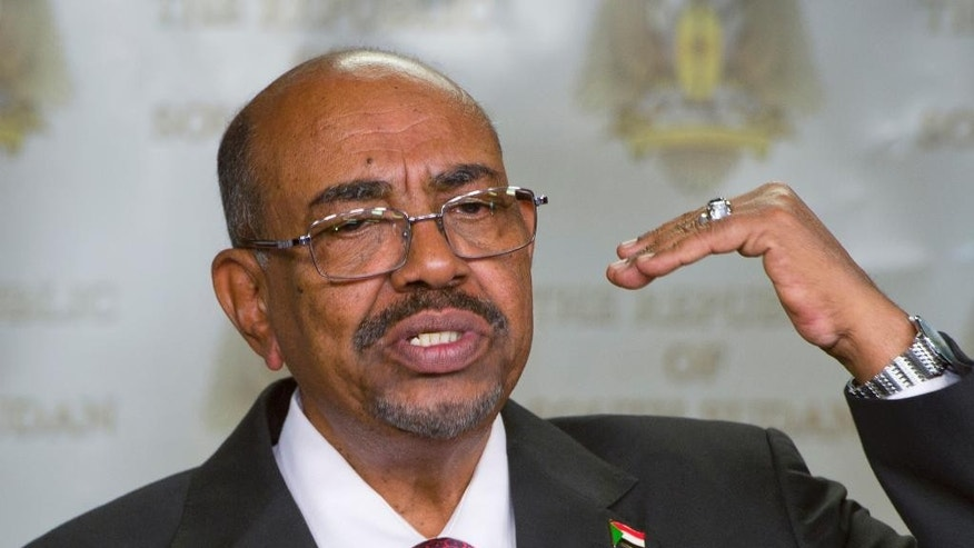 FILE - In this Monday, Jan. 6, 2014 file photo, Sudanese President Omar al-Bashir speaks after meeting with South Sudan's President Salva Kiir, in the capital Juba, South Sudan. A South African judge has ordered authorities to prevent Sudanese president, Omar al-Bashir, from leaving the country because of an international order for his arrest, human rights activists said Sunday, June 14, 2015. It was unclear whether authorities would heed efforts to have al-Bashir detained on behalf of the International Criminal Court, if he is indeed in South Africa. (AP Photo/Ali Ngethi, File)
