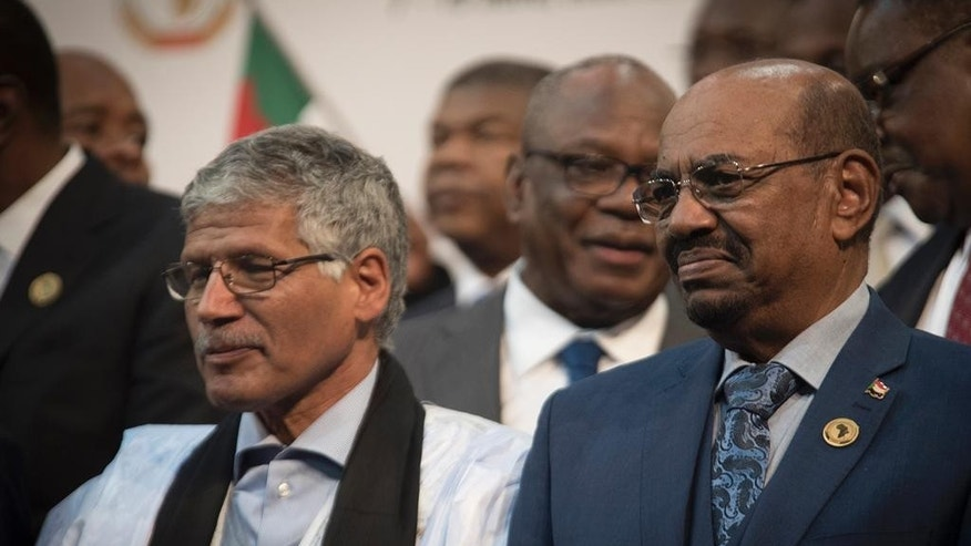 CAPTION CORRECTS THE NAME - Sudanese president Omar al-Bashir, right, stands with other African leaders during a photo op at the African Union summit in Johannesburg, Sunday June 14 2015.  The High Court in Pretoria has granted an interim order preventing al-Bashir from leaving South Africa, pending an application for his arrest. (AP Photo/Shiraaz Mohamed)
