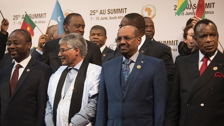 CAPTION CORRECTS THE NAME - Sudanese president Omar al-Bashir, right, stands with other African leaders during a photo op at the AU summit in Johannesburg, Sunday June 14 2015. The High Court in Pretoria has granted an interim order preventing Sudanese President  al-Bashir from leaving South Africa, pending an application for his arrest.(AP Photo/Shiraaz Mohamed)