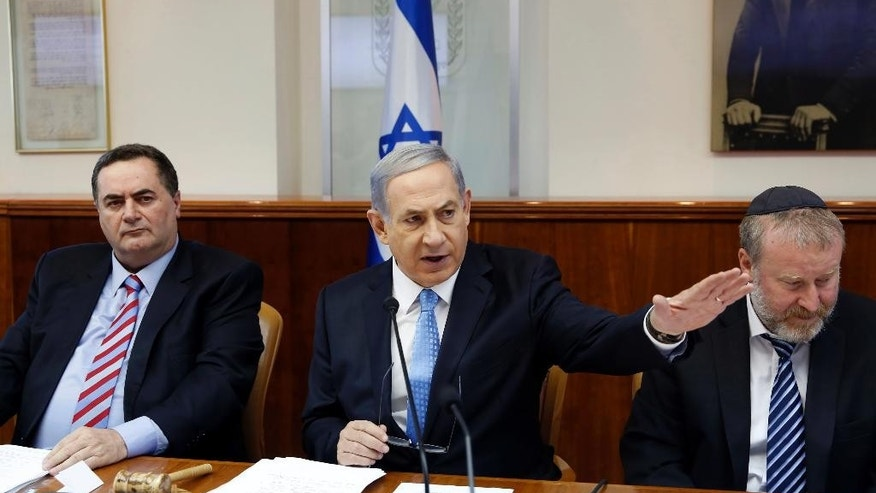 June 14, 2015: Israeli Prime Minister Benjamin Netanyahu chairs the weekly cabinet meeting with Cabinet Secretary Avichai Mandelblit, right and Transportation Minister Yisrael Katz, left, at the Prime Minister's office in Jerusalem.