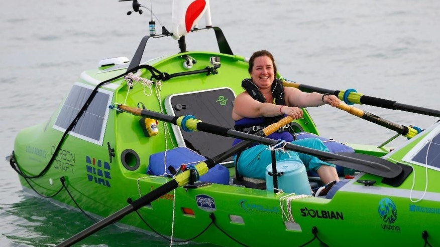 FILE - In this June 7, 2015, photo, American rower Sonya Baumstein rows a boat as she leaves Choshi Marina in Choshi, Japan, headed for San Francisco. Baumstein was rescued off the Japanese coast on Saturday, June 13, 2015,  after sending out a distress signal, Kyodo news agency reported on Sunday. The 30-year-old Baumstein was hoping to become the first woman to row solo across the Pacific.(AP Photo/Shizuo Kambayashi, File)