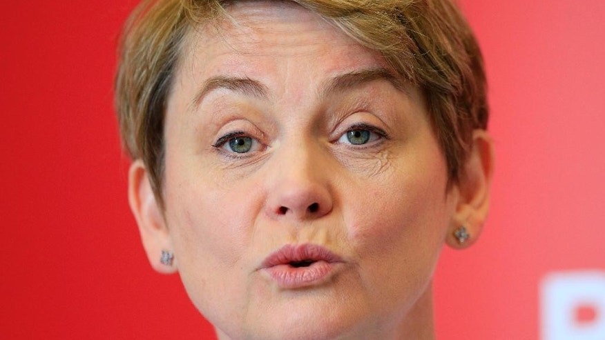 Yvette Cooper makes a speech in support of her Labour Party leadership campaign in London, Monday June 15, 2015.  There are four candidates to succeed Ed Miliband as leader of Britain's Labour Party, with Shadow health secretary Andy Burnham, shadow home secretary Yvette Cooper and shadow health minister Liz Kendall and veteran left-winger Jeremy Corbyn. (Jonathan Brady / PA via AP) UNITED KINGDOM OUT - NO SALES - NO ARCHIVES