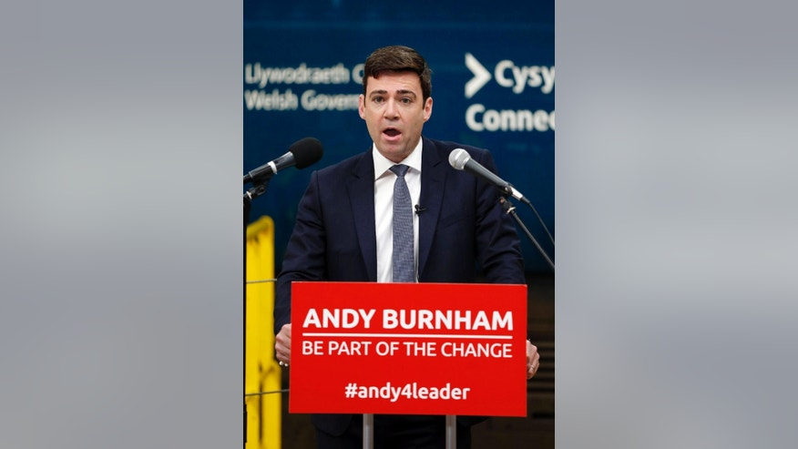 Candidate for the position of leader of the British Labour Party, Andy Burnham gives a speech during a visit to the Arriva train maintenance centre in Crewe, England, Monday June 15, 2015.  There are four candidates to succeed Ed Miliband as leader of the Labour Party, with Shadow health secretary Andy Burnham, shadow home secretary Yvette Cooper and shadow health minister Liz Kendall and veteran left-winger Jeremy Corbyn. (Lynne Cameron / PA via AP) UNITED KINGDOM OUT - NO SALES - NO ARCHIVES