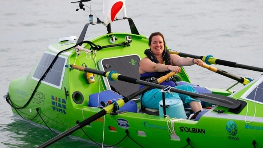 FILE - In this June 7, 2015, photo, American rower Sonya Baumstein rows a boat as she leaves Choshi Marina in Choshi, Japan, headed for San Francisco. Baumstein was rescued off the Japanese coast on Saturday, June 13, 2015,  after sending out a distress signal, Kyodo news agency reported on Sunday. (AP Photo/Shizuo Kambayashi, File)