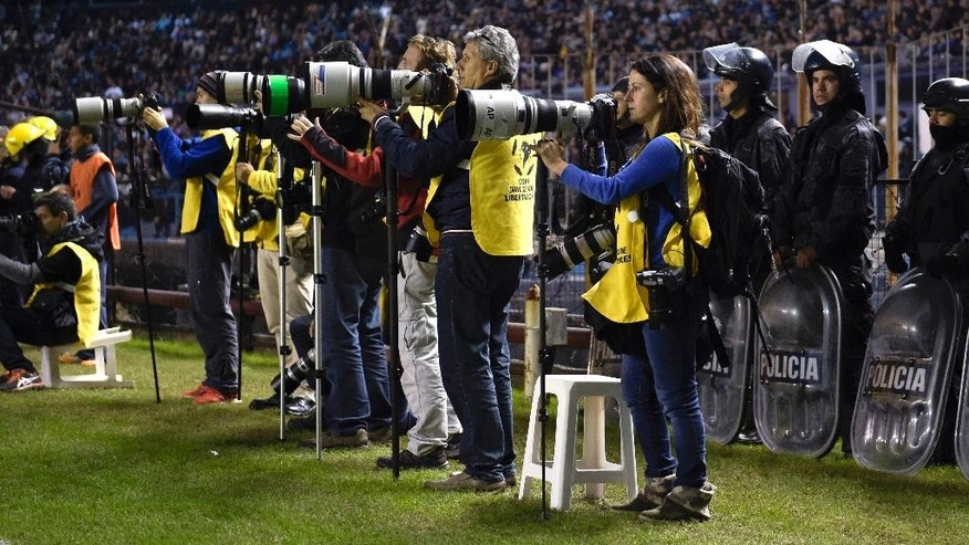 In this May 28, 2015 photo released by Natacha Pisarenko, Associated Press photographer Natacha Pisarenko covers a Copa Libertadores soccer game between Paraguay's Guarani and Argentina's Racing Club in Buenos Aires, Argentina. Pisarenko, a photojournalist who has covered major news and sports events across Latin America and around the world, has been named chief photographer for The Associated Press for the Southern Cone countries of Argentina, Uruguay, Paraguay and Chile. (Natacha Pisarenko via AP)