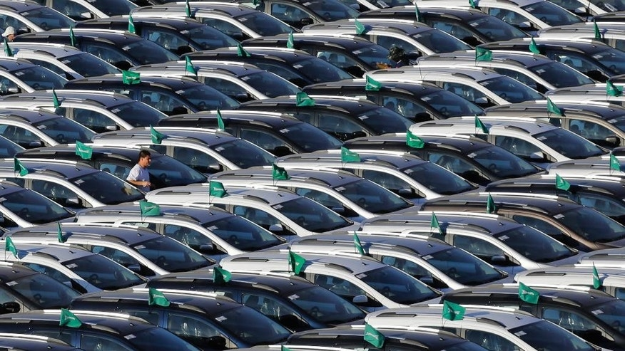 "In this June 11, 2015 photo, new cars sit parked in rows at the General Motors car park in Sao Bernardo do Campo, Brazil. Behind the worst crisis in more than a decade for the world's fourth-largest auto market is the ""uncertainty surrounding the country's sluggish economy, reduced access to credit and a drop in consumer confidence,"" said Rodrigo Baggi, an auto industry analyst at Sao Paulo's Tendencias Consultancy. ""Purchases of nonessential durable goods like cars, motorcycles and electrical appliances are being postponed."" (AP Photo/Nelson Antoine)"