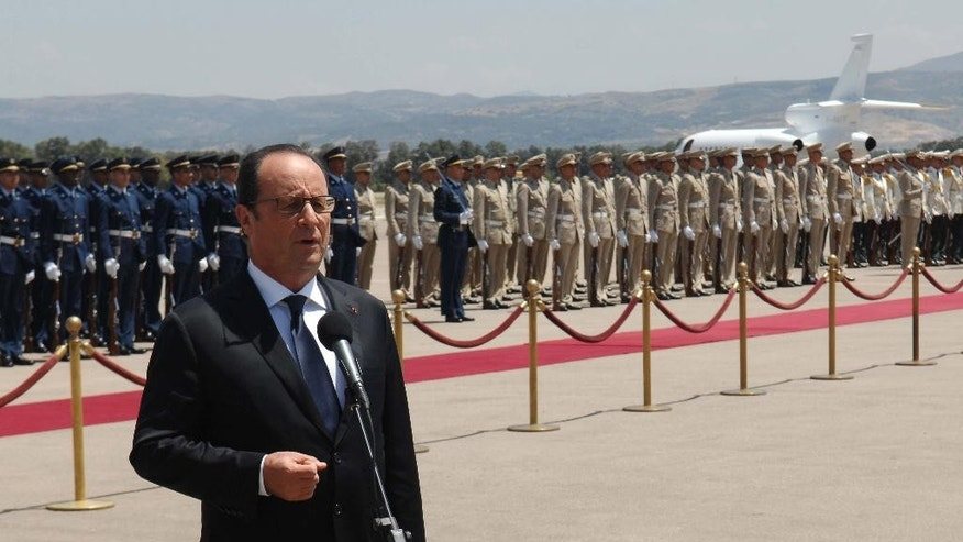 French President Francois Hollande, delivers a speech upon his arrival at Houari Boumediene airport in Algiers, Algeria, Monday, June 15, 2015. Hollande made a fleeting visit to Algiers for a few hours to meet his Algerian counterpart Abdelaziz Bouteflika. (AP Photo/Sidali Djarboub)