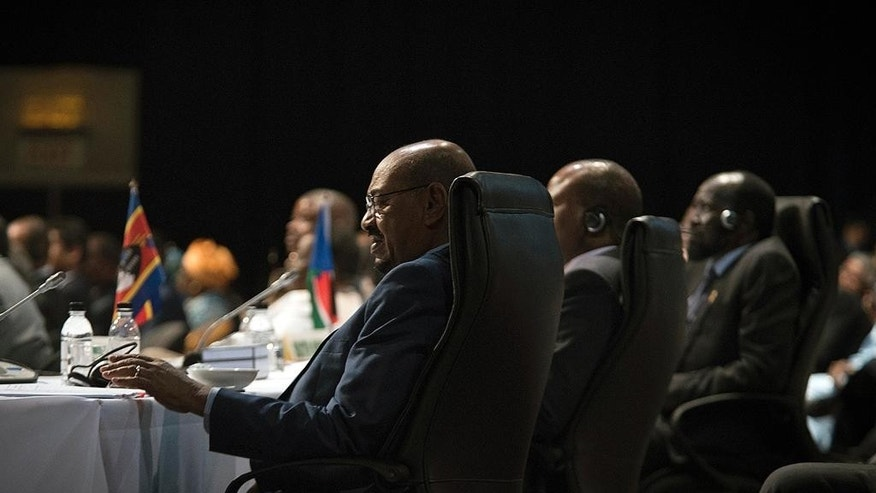 Sudanese president Omar al-Bashir is seen during the opening session of the AU summit in Johannesburg, Sunday, June 14, 2015. A South African judge on Sunday ordered authorities to prevent  al-Bashir,  from leaving the country because of an international order for his arrest, human rights activists said.(AP Photo/Shiraaz Mohamed)