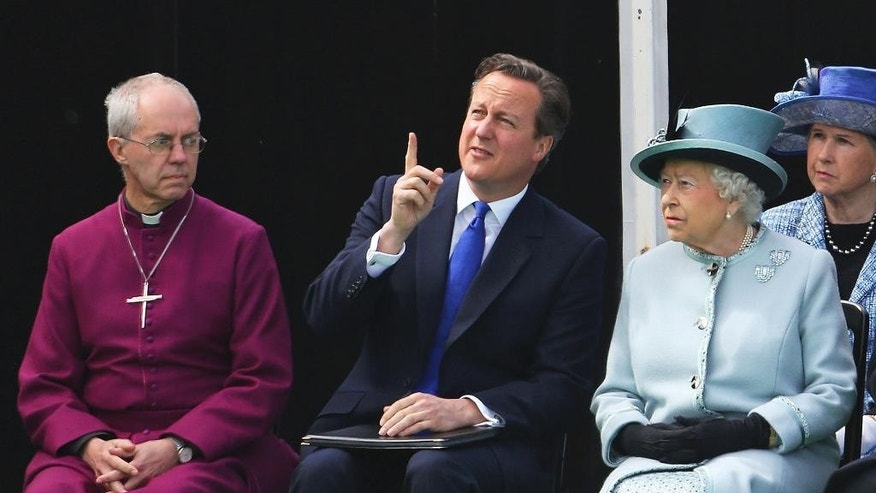 Seated near the Magna Carta memorial at Runnymede, England, are from left, The Archbishop of Canterbury Justin Welby, Prime Minister David Cameron, and Queen Elizabeth II, ahead of a commemoration ceremony Monday June 15, 2015, to celebrate the 800th anniversary of the groundbreaking accord called Magna Carta. In 1215, Britain's King John met disgruntled barons at Runnymede and agreed to a list of basic rights and laws which have formed the basic tenets of modern civil liberties which exist today, and was an inspiration for the U.S. Constitution among many other worldwide influences. (Steve Parsons / Pool photo via AP)