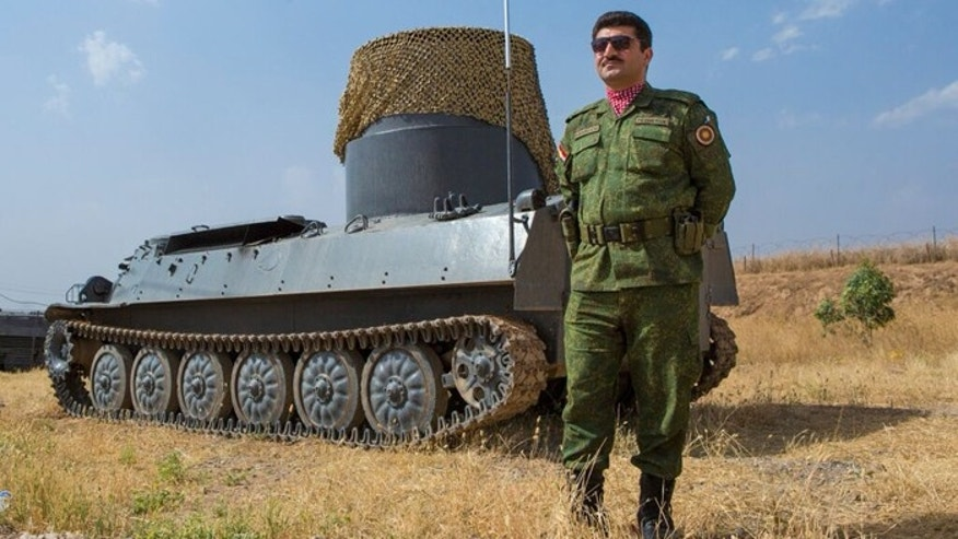 Barzani had this seized tank converted into an anti-mine vehicle. (Gavin John)