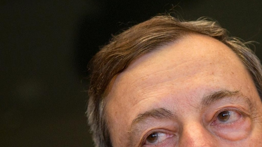 European Central Bank Governor Mario Draghi waits for the start of a meeting of the Economic and Monetary Affairs Committee at the European Parliament in Brussels on Monday, June 15, 2015. (AP Photo/Virginia Mayo)