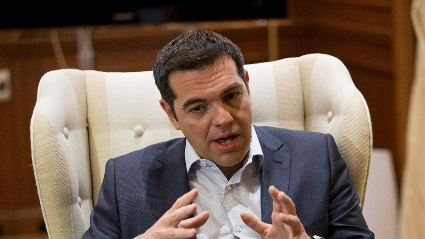 "Greek Prime Minister Alexis Tsipras gestures during a meeting with Stavros Theodorakis, leader of the political party To Potami (The River) at his office in central Athens Tuesday, June 16, 2015. Greece insisted Monday it is ready to return to bailout talks ""at any moment"" after a breakdown in negotiations with creditors pushed the country closer toward bankruptcy and jolted international markets. (AP Photo/Petros Giannakouris)"