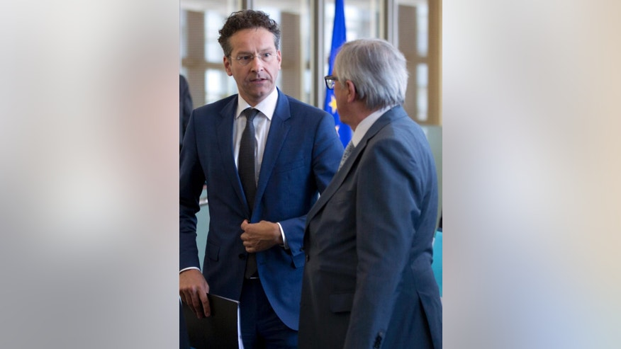 European Commission President Jean-Claude Juncker, right, speaks with Dutch Finance Minister and chair of the eurogroup Jeroen Dijsselbloem after a meeting at EU headquarters in Brussels on Tuesday, June 16, 2015. This meeting is preliminary for the upcoming EU summit. (AP Photo/Virginia Mayo)