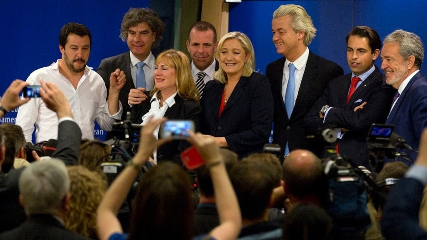 French far right party, Front national, President Marine Le Pen, center right, poses with other members of the far right after a media conference at the European Parliament in Brussels on Tuesday, June 16, 2015. The far right parties in the European Parliament say they have mustered enough unity to form a political group in the European Parliament under the leadership of France's National Front of Marine Le Pen. (AP Photo/Virginia Mayo)