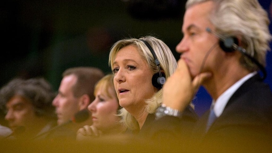 French far right party, Front national, President Marine Le Pen, second right, speaks during a media conference at the European Parliament in Brussels on Tuesday, June 16, 2015. The far right parties in the European Parliament say they have mustered enough unity to form a political group in the European Parliament under the leadership of France's National Front of Marine Le Pen. At right is Dutch far-right Freedom Party leader Geert Wilders. (AP Photo/Virginia Mayo)