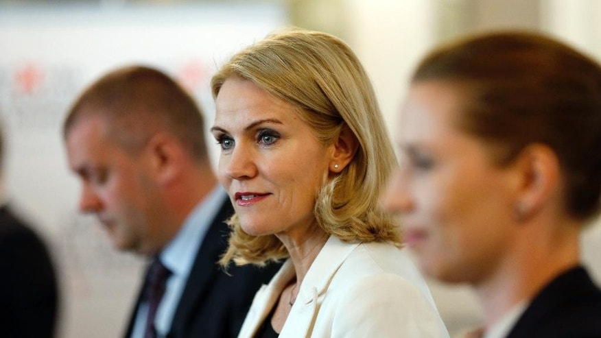 The Social Democrats, headed by Prime Minieter Helle Thorning-Schmidt, center, Minister of Finance Bjarke Corydon, left, and Minister of Justice Mette Frederiksen, held it's closing press conference of their election campaign in the Danish Parliament Christiansborg Castle, Wednesday June 17. 2015, in Copenhagen.  Denmark will hold a mandatory general election Thursday June 18 after almost four years of coalition Government between the Social Democrats and the Social-Liberal Party. (Jens Dresling/Polfoto via AP) DENMARK OUT