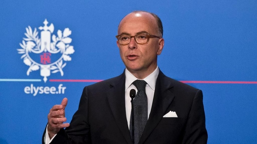 France's Interior Minister Bernard Cazeneuve, speaks to the media during a media conference at the Elysee Palace in Paris, Wednesday, June 17, 2015.  Interior Minister Bernard Cazeneuve announced during a media conference a plan to handle the influx of migrants. (AP Photo/Michel Euler)