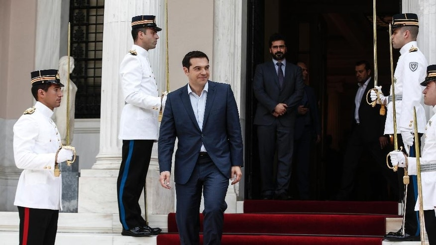 Greece's Prime Minister Alexis Tsipras makes his way to welcome visiting Austrian Chancellor Werner Faymann in Athens, Greece, on Wednesday, June 17, 2015. Athens must pay 1.6 billion euros ($1.8 billion) off its debts at the end of the month to avoid a possible default and secure its cherished place among the 19 countries using the single currency for a little longer.(AP Photo/Yorgos Karahalis)