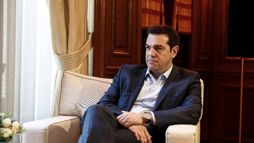 Greece's Prime Minister Alexis Tsipras listens to visiting Austrian Chancellor Werner Faymann in Athens, Greece, on Wednesday, June 17, 2015. Athens must pay 1.6 billion euros ($1.8 billion) off its debts at the end of the month to avoid a possible default and secure its cherished place among the 19 countries using the euro single currency.(AP Photo/Yorgos Karahalis)