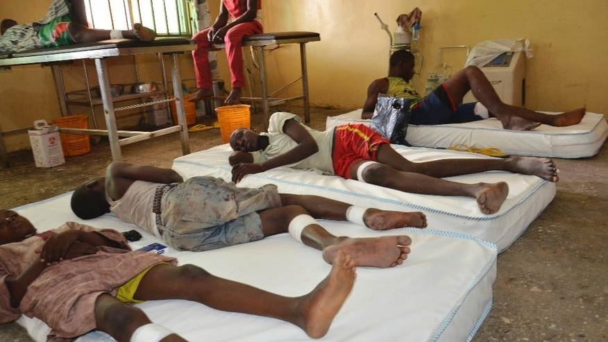 Victims receive treatment at a hospital, after an explosion in Maiduguri, Nigeria, Wednesday, June 17, 2015.  A large sack of home-made bombs discovered at an abandoned Boko Haram camp exploded, killing 63 people, witnesses said Wednesday of a toll many times higher than in any recent attack in northeast Nigeria. The explosives were found by civilian self-defense fighters who carried the bag filled with metal objects to the nearby town of Monguno, said fighters including Haruna Bukar. (AP Photo/Jossy Ola)