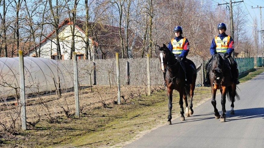 Feb. 13, 2015: Mounted police officers patrol in the vicinity of Morahalom, southeast of Budapest, Hungary, next to the Serbian border.