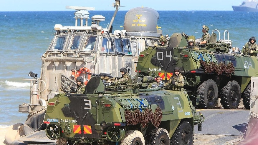 Soldiers sit atop of amphibious vehicles as NATO troops participate in the NATO sea exercises BALTOPS 2015 that are to reassure the Baltic Sea region allies in the face of a resurgent Russia, in Ustka, Poland, Wednesday, June 17, 2015. (AP Photo/Czarek Sokolowski)