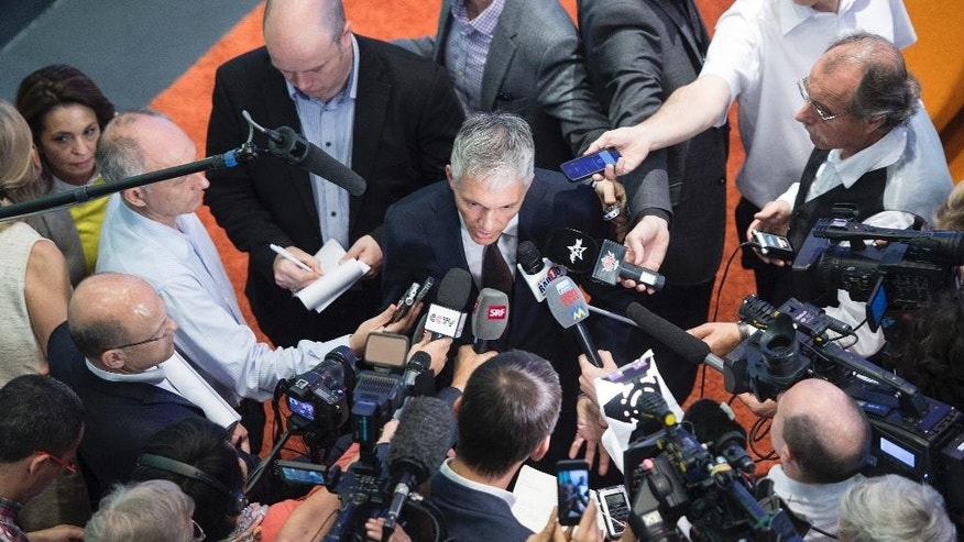 Swiss attorney general Michael Lauber, center, speaks to journalists after a press conference in Bern, Switzerland, Wednesday, June 17, 2015. Lauber said in the press conference that banks have noted 53 possible money-laundering cases in a FIFA probe. (Marcel Bieri/Keystone via AP)