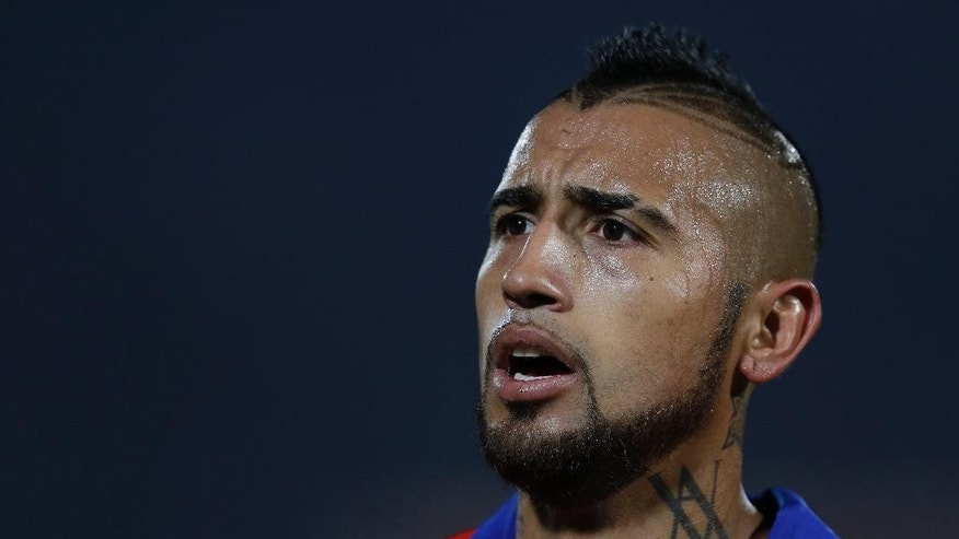 Chile's Arturo Vidal leaves at half time during a Copa America Group A soccer match against Mexico at El Nacional stadium in Santiago, Chile, Monday, June 15, 2015. According to reports from the local press in Chile, Vidal was involved in a traffic accident when he crashed a red Ferrari sports car in the outskirts of Santiago. Vidal is reported to have suffered only light injuries, according to Janet Moreno of the San Luis de Buin hospital where he was admitted after the crash. (AP Photo/Natacha Pisarenko)