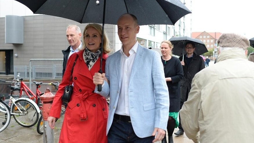 Danish Prime Minister and head of the Social Democrats, Helle Thorning-Schmidt, and her husband British politician Stephen Kinnock, arrive Thursday June 18, 2015 at the polling station in Copenhagen. Denmark is holding a general election Thursday where approximately 4 million voters are entitled to cast their ballots to elect the 179 members of the parliament. (Lars Krabbe/Polfoto via AP) DENMARK OUT