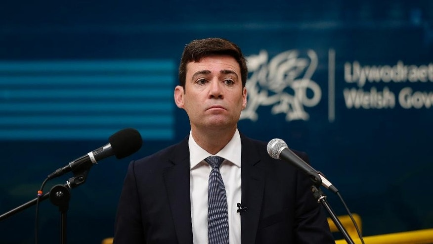 FILE - A Monday, June 15, 2015 file photo showing Labour leadership candidate, Andy Burnham, during a speech in Crewe, England. Weeks after an electoral trouncing, Britain's opposition Labour Party is seeking a chief who can tell voters _ and party members _ what it stands for. The candidates include two survivors from past Labour governments, a lawmaker inspired by former Prime Minister Tony Blair and an old-time socialist left-winger. (Lynne Cameron/PA via AP, File) UNITED KINGDOM OUT  NO SALES  NO ARCHIVE