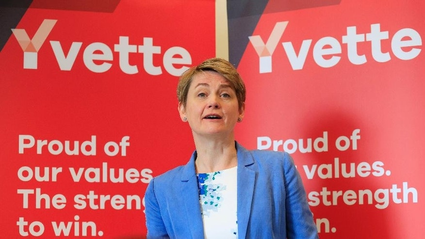 FILE - A Monday June 15, 2015 file photo of Yvette Cooper making a speech in support of her Labour Party leadership campaign in London. Weeks after an electoral trouncing, Britain's opposition Labour Party is seeking a chief who can tell voters _ and party members _ what it stands for. The candidates include two survivors from past Labour governments, a lawmaker inspired by former Prime Minister Tony Blair and an old-time socialist left-winger. (Jonathan Brady/PA via AP, File) UNITED KINGDOM OUT  NO SALES  NO ARCHIVE