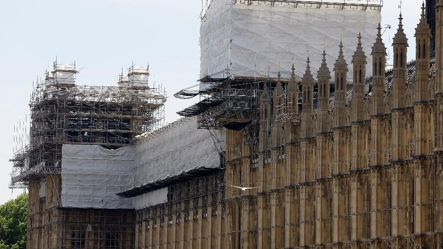 Scaffolding surrounds the Houses of Parliament in Westminster in London, Thursday, June 18, 2015. Britain's Parliament is falling apart. That's not a political criticism, but the judgment of a report that says the crumbling 19th-century complex needs repairs that could take three decades and cost up to 7 billion pounds ($11 billion). (AP Photo/Kirsty Wigglesworth)