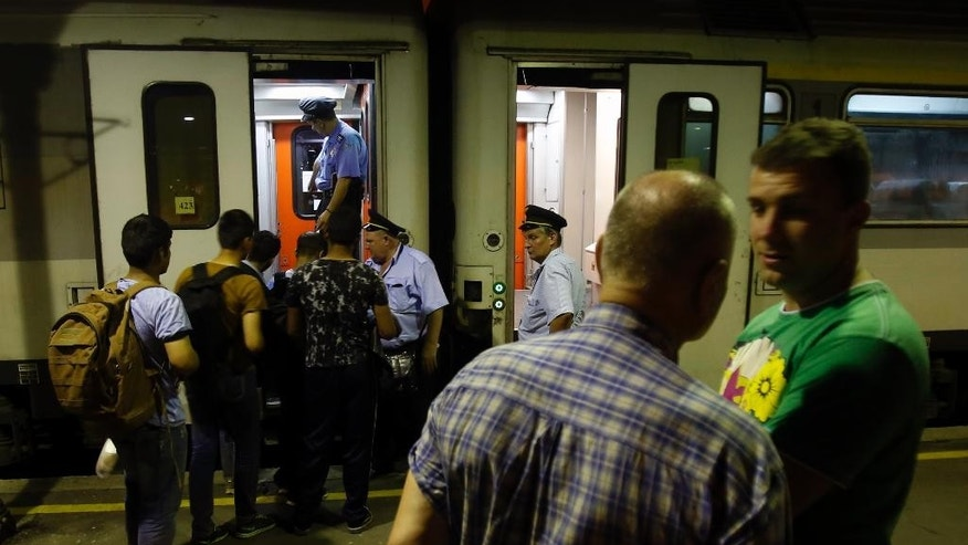 "In this photo taken Tuesday, June 2, 2015, migrants getting on the train for Northern Serbian town of Subotica, near the Hungarian border, in Belgrade, Serbia. Serbia's prime minister Aleksandar Vucic says he is ""shocked"" by Hungary's plans to build a fence along the border with Serbia to stop a flow of migrants reaching the country. (AP Photo/Darko Vojinovic)"