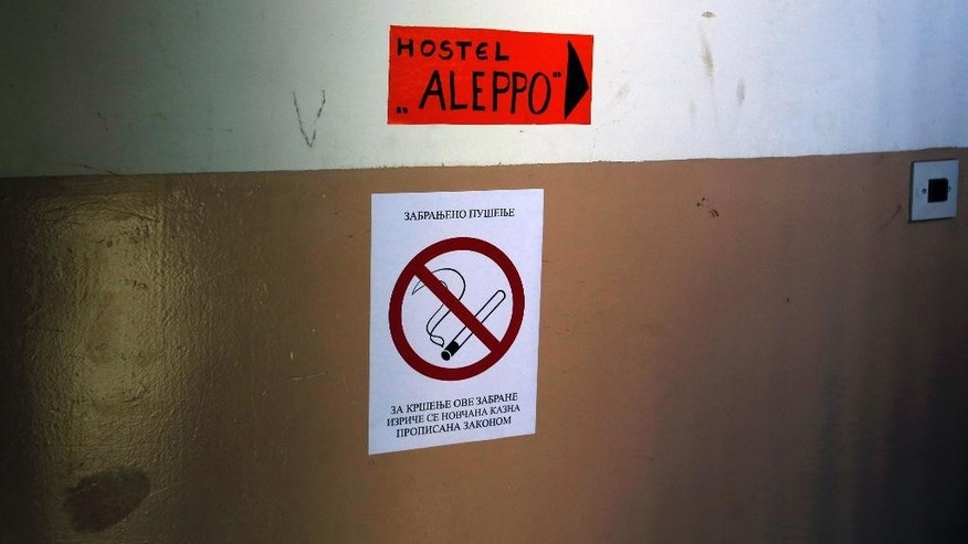 "In this photo taken Tuesday, June 2, 2015, is a guide mark for ""Aleppo"" hostel in a hall of a building in Belgrade, Serbia. Serbia's prime minister Aleksandar Vucic says he is ""shocked"" by Hungary's plans to build a fence along the border with Serbia to stop a flow of migrants reaching the country. (AP Photo/Darko Vojinovic)"