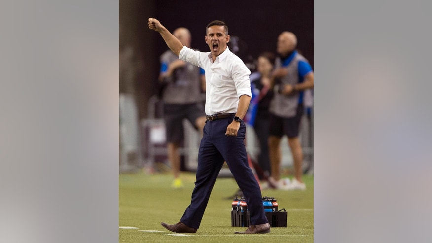 Canada coach John Herdman disputes a call during the second half of a FIFA Women's World Cup soccer match between Canada and the Netherlands on Monday, June 15, 2015, in Montreal, Canada. (Ryan Remiorz/The Canadian Press via AP)