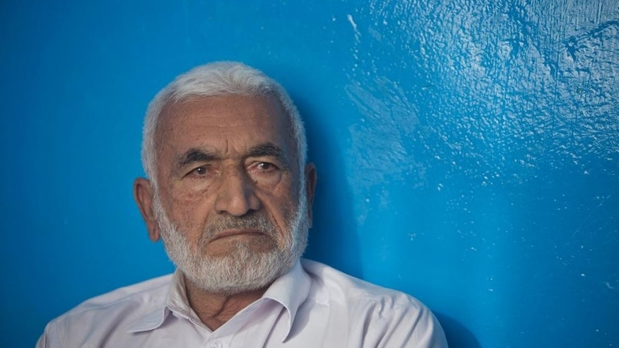 In this Sunday, June 14, 2015, photo, Mohammad Nader Malikzada, 72, father of Farkhunda Malikzada, a young Afghan woman who was beaten to death by a mob, talks during an interview with The Associated Press at his home in Kabul, Afghanistan. (AP Photo/Massoud Hossaini)