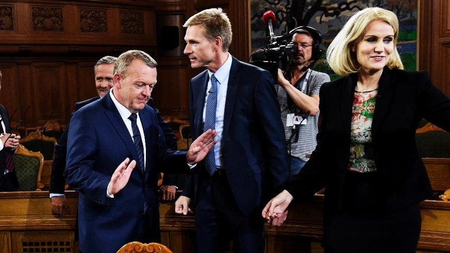 Anders Samuelsen, left, head of the Liberal Alliance, Lars Loekke Rasmussen, second left, head of the Liberal Party, Kristian Thulesen Dahl, second center, head of the Danish People's Party and Helle Thorning-Schmidt, right, head of the Social Democrats, arrive for a live televised debate after the result of the election became clear early Friday morning, June 19. 2015 in the Parliament at Christiansborg Castle in Copenhagen. Denmark's center-right opposition won a parliamentary election after strong gains by an anti-immigration party that wants to limit the European Union's influence over the small Nordic country. Thorning-Schmidt announced her resignation as prime minister and the leader of the party. (Casper Dalhoff/Polfoto via AP) DENMARK OUT