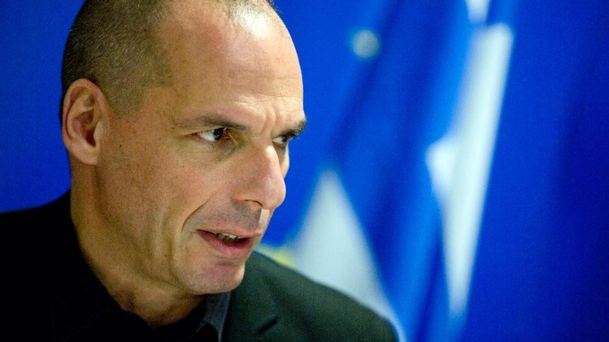 Greek Finance Minister Yanis Varoufakis speaks during a media conference after a meeting of eurogroup finance ministers at the European Council building in Luxembourg on Thursday, June 18, 2015. Greece faced intense pressure Thursday from its international creditors to break a deadlock in bailout discussions that's raised the specter of the country's imminent bankruptcy and even its exit from the euro. (AP Photo/Virginia Mayo)