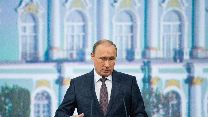 Russian President Vladimir Putin speaks during a plenary session of the St. Petersburg International Investment Forum in St. Petersburg, Russia, Friday, June 19, 2015.  (AP Photo/Alexander Zemlianichenko)