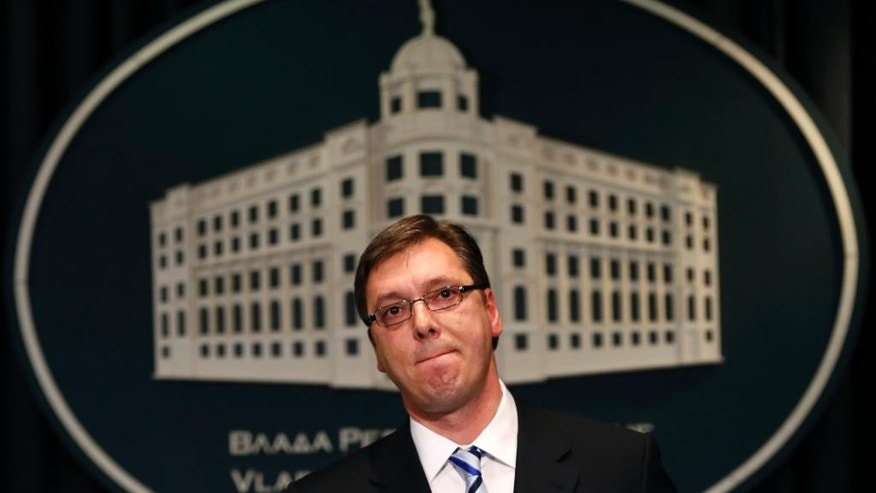 Serbia's Prime Minister Aleksandar Vucic listens to questions during a press conference in Belgrade, Serbia, Friday, June 19, 2015. Vucic, who is a former hardline nationalist, said he is ready to attend the memorial ceremonies in July marking the 20th anniversary of the massacre in Srebrenica.(AP Photo/Darko Vojinovic)