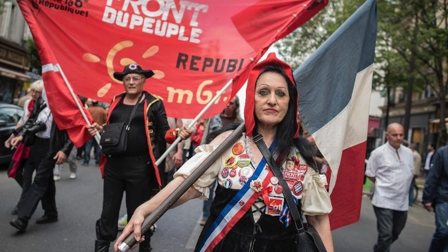A woman dressed as Marianne, the symbol of the French republic since the 1789 revolution, is seen during a demonstration against austerity in support of the Greek population in Paris, France, Saturday, June 20, 2015. Europe is scrambling to pick up the pieces after another failed meeting over Greece's bailout which reinforced fears that the country was heading for bankruptcy and euro exit. (AP Photo/Kamil Zihnioglu)