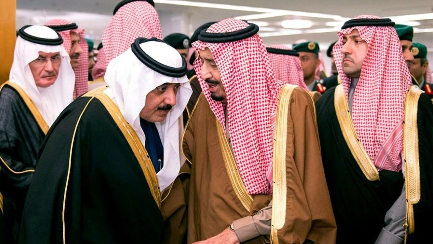 FILE - In this Jan. 24, 2015 file photo provided by the Saudi Press Agency, Saudi King Salman, center, speaks to Crown Prince Muqrin, center left, in the king's dewaniya, a traditional Arab reception area to receive guests, where condolences for Saudi King Abdullah, are being received, in Riyadh, Saudi Arabia. WikiLeaks is in the process of publishing more than 500,000 Saudi diplomatic documents to the Internet, the transparency website said Friday, June 19, 2015. If genuine, the documents would offer a rare glimpse into the inner workings of the notoriously opaque kingdom. (Saudi Arabian Press Agency via AP, File)