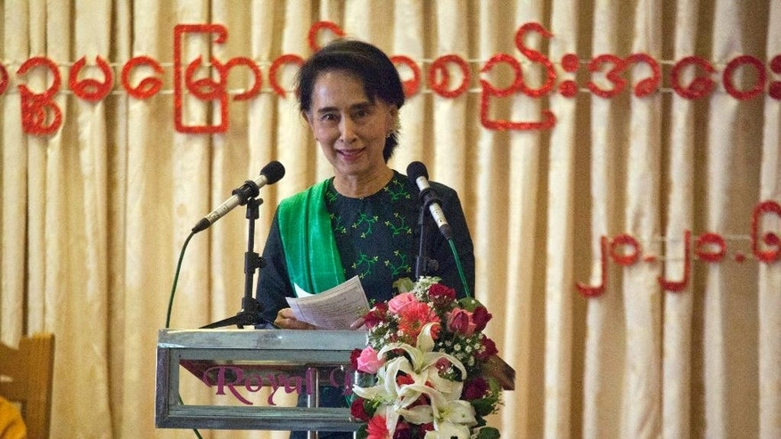 Myanmar opposition leader Aung San Suu Kyi speaks during a meeting of her National League for Democracy Party's first Central Executive Committee at Royal Rose restaurant  in Yangon, Myanmar Saturday, June 20, 2015. (AP Photo/Khin Maung Win)