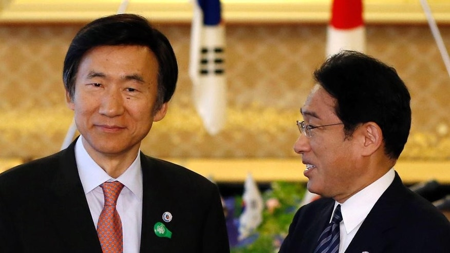 South Korea's Foreign Minister Yun Byung-se, left, talks with Japan's Foreign Minister Fumio Kishida before their meeting at the foreign ministry's Iikura guest house in Tokyo Sunday, June 21, 2015. (Issei Kato/Pool Photo via AP)