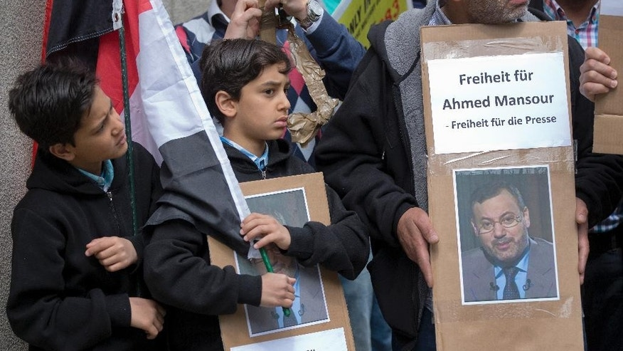 "Young boys attend a protest rally to support the release of the journalist Ahmed Mansour in Berlin, Germany, Sunday, June 21, 2015. Ahmed Mansour, 52, a senior journalist with the Qatar-based broadcaster Al-Jazeera, was detained at Tegel airport on Saturday on an Egyptian arrest warrant, Al-Jazeera said. Posters read: ""Freedom for Ahmed Mansour - Freedom for the press"". (AP Photo/Michael Sohn)"